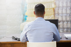 Warehouse manager working on computer Stock Photos