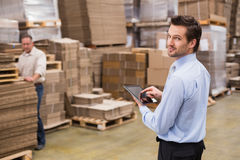 Warehouse manager working on tablet pc Stock Photo