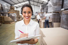 Warehouse manager writing on clipboard Royalty Free Stock Photos