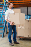 Warehouse managers loading a trolley Royalty Free Stock Photography