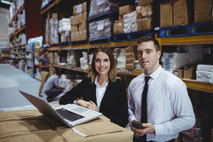 Warehouse managers using laptop Royalty Free Stock Image