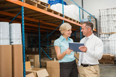 Warehouse managers using tablet pc Royalty Free Stock Photography