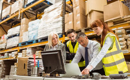 Warehouse managers and worker talking Stock Photos