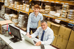 Warehouse managers working together on laptop Royalty Free Stock Photography