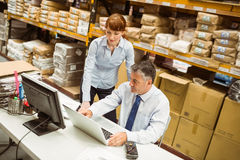 Warehouse managers working together on laptop Stock Photos