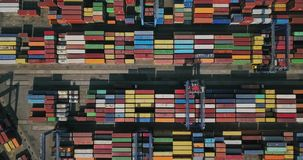 Warehouse with many containers. Odessa, Ukraine - 24 July 2017: Big warehouse with many multicolored containers. There are cranes and trucks. Aerial video stock video footage