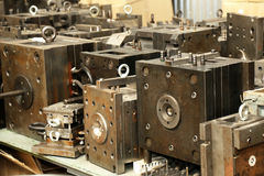 Warehouse metal workpieces and equipment obsolete mechanical pla Stock Photography