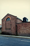 Warehouse. Old warehouse, view from street. Vintage colors Royalty Free Stock Photos