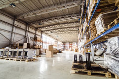Warehouse and pallets. Pallets storing boxes in an industrial warehouse Royalty Free Stock Image