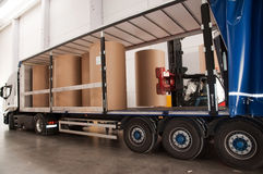 Warehouse (paper) with forklift and truck Stock Images