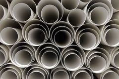 Warehouse of polypropylene plastic industrial pipes stock image
