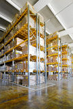 Warehouse racks. Tall shelves and racks in distribution warehouse royalty free stock photo
