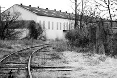 Warehouse by railroad tracks Royalty Free Stock Photo