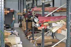 Warehouse of rolls of natural leather. Stock Photos