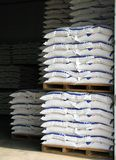 Warehouse with Sacks. Stacked high on wooden pallets, all visible trademarks have been removed Royalty Free Stock Photo