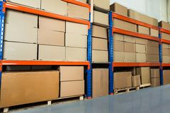 Warehouse Shelf With Cardboard Boxes Royalty Free Stock Photography