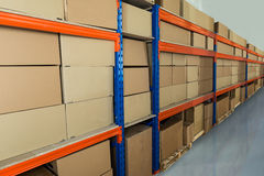 Warehouse Shelf With Cardboard Boxes Royalty Free Stock Images