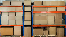 Warehouse Shelf With Cardboard Boxes Stock Images