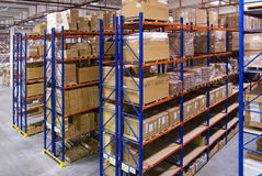 Warehouse with shelves and boxes Stock Image
