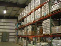 Warehouse with shelves full of bulk product Stock Image