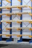 Warehouse shelves. Loaded with wood plank boards Royalty Free Stock Photo
