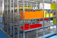 Warehouse shelving. Shelving system with colorful boxes in warehouse Stock Photography