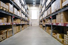 Warehouse-shop. The interior of the warehouse. The shelves in several rows. royalty free stock photos