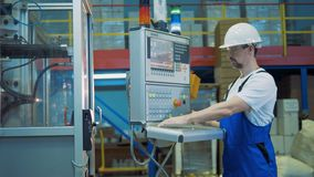Warehouse specialist is operating a control board. 4K stock footage