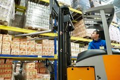 Warehouse stacker loader worker Stock Images
