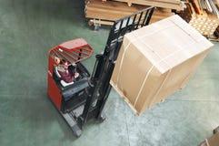 Warehouse stacker at work Royalty Free Stock Photos