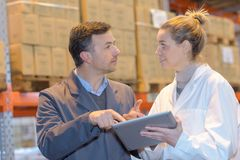 Warehouse staffs having argument Stock Photography