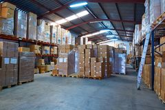 Warehouse stograge with stacked boxes in rows Royalty Free Stock Image