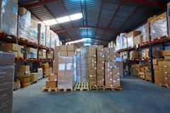 Warehouse stograge with stacked boxes in rows Stock Photo