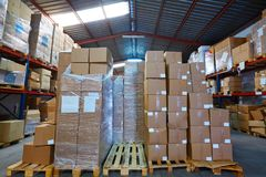Warehouse stograge with stacked boxes in rows Stock Photos