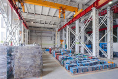 Warehouse storage of molds and tools. Warehouse storage machines molds packed in polyethylene and hoisting crane Stock Image