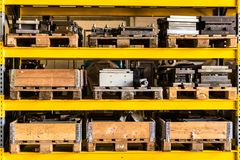 Warehouse storage shelf packed with wooden boxes and pallets stock photo