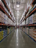 Warehouse of a supermarket. Different consumer goods are kept inside the warehouse of a supermarket for future use Stock Photos