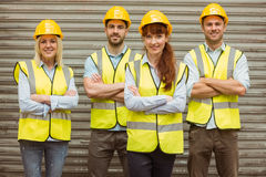 Warehouse team with arms crossed wearing hard hat Royalty Free Stock Image