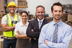 Warehouse team smiling at camera Stock Image