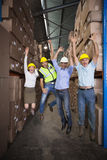 Warehouse team smiling at camera jumping and cheering Stock Photography