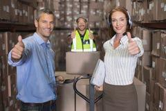 Warehouse team smiling at camera Royalty Free Stock Image