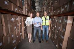 Warehouse team smiling at camera Stock Image