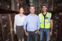 Warehouse team smiling at camera Stock Photography
