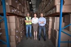Warehouse team smiling at camera Stock Photos