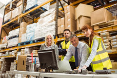 Warehouse team smiling at camera Royalty Free Stock Photography