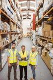 Warehouse team smiling at camera Royalty Free Stock Photos