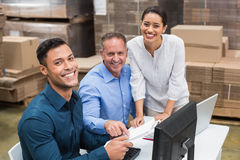 Warehouse team smiling at camera Royalty Free Stock Images