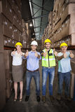 Warehouse team smiling at camera showing thumbs up Royalty Free Stock Images