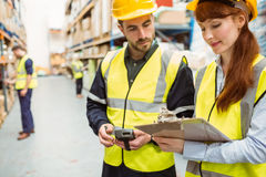 Warehouse team working together with clipboard Royalty Free Stock Photography