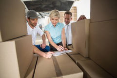 Warehouse team working together with clipboard Royalty Free Stock Photo